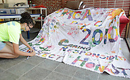 Middletown, New York - A staff member at the Middletown YMCA summer camp works on a banner on August 20, 2010.