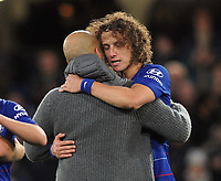 Football - 2018 / 2019 Premier League - Chelsea vs. Manchester City<br /> <br /> Man City Manager comes onto the pitch at the final whistle to give Chelsea goalscorer, David Luiz a hug, at Stamford Bridge.<br /> <br /> COLORSPORT/ANDREW COWIE