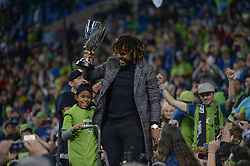 November 30, 2017 - Seattle, Washington, U.S - Soccer 2017: Seattle Sounder ROMAN TORRES  celebrates the Western Conference title with the Emerald City supporters after the game as the Seattle Sounders beat the Houston Dynamo in the 2nd leg of the MLS Western Conference Finals match at Century Link Field in Seattle, WA. (Credit Image: © Jeff Halstead via ZUMA Wire)