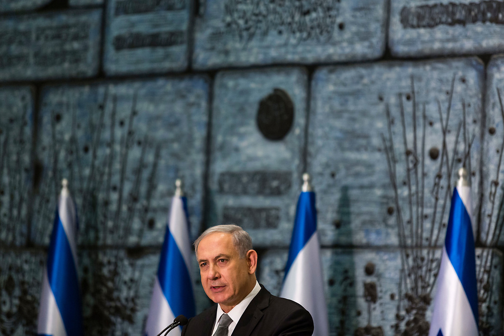 Israeli Prime Minister Benjamin Netanyahu speaks during an award ceremony honoring those in the fight against human trafficking, at the President's Residence in Jerusalem, Israel, on December 2, 2014. Israel appears to be heading towards an early election after Prime Minister Netanyahu fired ministers Livni and Lapid from his coalition government having failed to patch up differences.