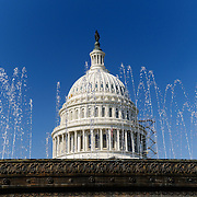 The US Capitol Dome seen through the water fountains above the new US Capitol Visitors Center. Shallow depth of field--focus on the dome