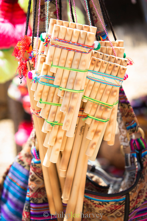 Hand made flutes being sold on the Floating islands of Lake Titicaka, Puno, Peru, South America