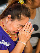 19 AUGUST 2015 - BANGKOK, THAILAND: A woman prays during the reopening of Erawan Shrine. Erawan Shrine in Bangkok reopened Wednesday morning after more than 20 people were killed and more than 100 injured in a bombing at the shrine Monday, August 17, 2015. The shrine is a popular tourist attraction in the center of Bangkok's high end shopping district and is an important religious site for Thais. No one has claimed responsibility for the bombing.      PHOTO BY JACK KURTZ