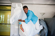 5th June 2010. Las Vegas, Nevada. Known around the world as one of the most Famous places to be married, The Little White Wedding Chapel in Las Vegas has wed stars from Britney Spears to Judy Garland. Pictured are two guests climbing on a display after a few drinks. PHOTO © JOHN CHAPPLE / www.chapple.biz.john@chapple.biz  (001) 310 570 9100.