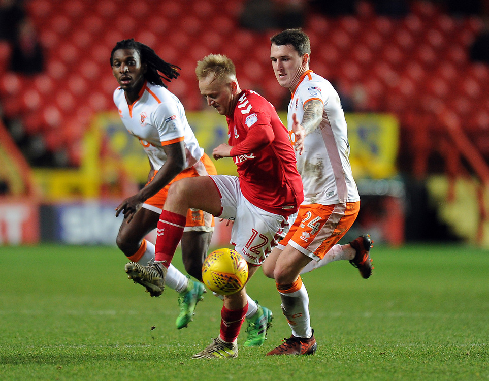 Charlton Athletic's Ben Reeves holds off the challenge from Blackpool's Callum Cooke<br /> <br /> Photographer Ashley Western/CameraSport<br /> <br /> The EFL Sky Bet League One - Charlton Athletic v Blackpool - Saturday 23rd December 2017 - The Valley - London<br /> <br /> World Copyright © 2017 CameraSport. All rights reserved. 43 Linden Ave. Countesthorpe. Leicester. England. LE8 5PG - Tel: +44 (0) 116 277 4147 - admin@camerasport.com - www.camerasport.com
