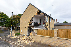 © Licensed to London News Pictures. 15/09/2018. Brierley UK. The full extent of damage caused to a house when a lorry crashed into it can be seen this morning in the Brierley area of Barnsley. South Yorkshire police have said a marked police car was following the stolen lorry when the lorry hit a female pedestrian in her 50's who has died before crashing into the house on Park View, in Brierley at 13:40 yesterday. Four men have been arrested in connection with the crash. Photo credit: Andrew McCaren/LNP