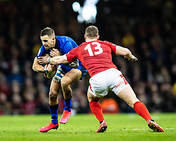 Mattia Bellini of Italy under pressure from  George North of Wales<br /> <br /> Photographer Simon King/Replay Images<br /> <br /> Six Nations Round 1 - Wales v Italy - Saturday 1st February 2020 - Principality Stadium - Cardiff<br /> <br /> World Copyright © Replay Images . All rights reserved. info@replayimages.co.uk - http://replayimages.co.uk