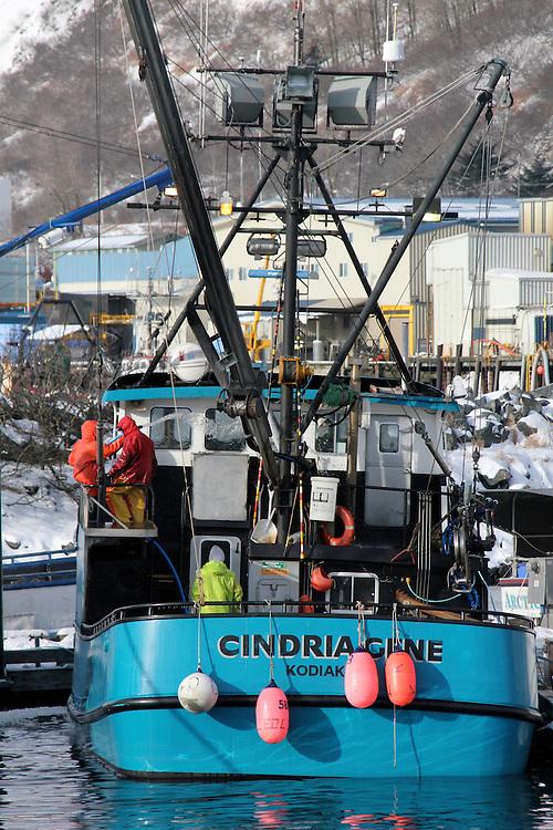 Crewmembers working aboard the Cindra Gene, a fishing vessel in the St. Paul Harbor, Kodiak Island, Alaska.