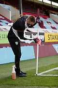 Groundstaff disinfecting a corner flag during the Premier League match between Burnley and Brighton and Hove Albion at Turf Moor, Burnley, England on 26 July 2020.