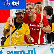 NLD/Amsterdam/20100807 - Boten tijdens de Canal Parade 2010 door de Amsterdamse grachten. De jaarlijkse boottocht sluit traditiegetrouw de Gay Pride af. Thema van de botenparade was dit jaar Celebrate, AVRO boot, Henk Krol
