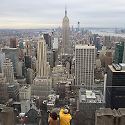 A vertical view of Manhattan, New York, from the Top of the Rock, the observatory deck at Rockefeller Center showing the Empire State Building, Manhattan, New York, USA.  Photo Tim Clayton