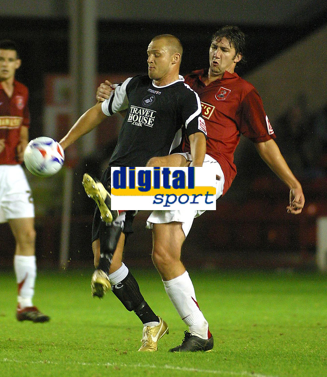 Photo: Dave Linney.<br />Walsall v Swansea City. Johnstone's Paint Trophy. 17/10/2006.Walsall defender Ian Roper(R) gets a foot to the ball before  Lee Trundle