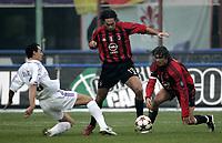 Milano 12-12-2004<br /> <br /> Campionato di calcio Serie A 2004-05<br /> <br /> Milan Fiorentina<br /> <br /> nella  foto Alessandro Nesta (Milan) betwwen Dario Dainelli Fiorentina (L) and Paolo Maldini Milan (R)<br /> <br /> Foto Snapshot / Graffiti