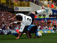 Photo. Javier Garcia<br />18/04/2003 Spurs v Man City, FA Barclaycard Premiership, White Hart Lane<br />Stephen Carr tumbles over Shaun Wright Phillips