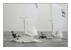 470 Class European Championships Largs - Day 2.Wet and Windy Racing in grey conditions on the Clyde..SUI12, Fiona TESTUZ, Anne-sophie THILO, Club Nautique Pully and GBR0, Sophie WEGUELIN, Sophie AINSWORTH, Royal Lymington Yacht Club ...