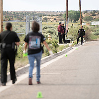 Gallup Police Department collects evidence on Kachina Street behind Wal-Mart as they investigate a stabbing that took place in the area, Wednesday, June 5 in Gallup.