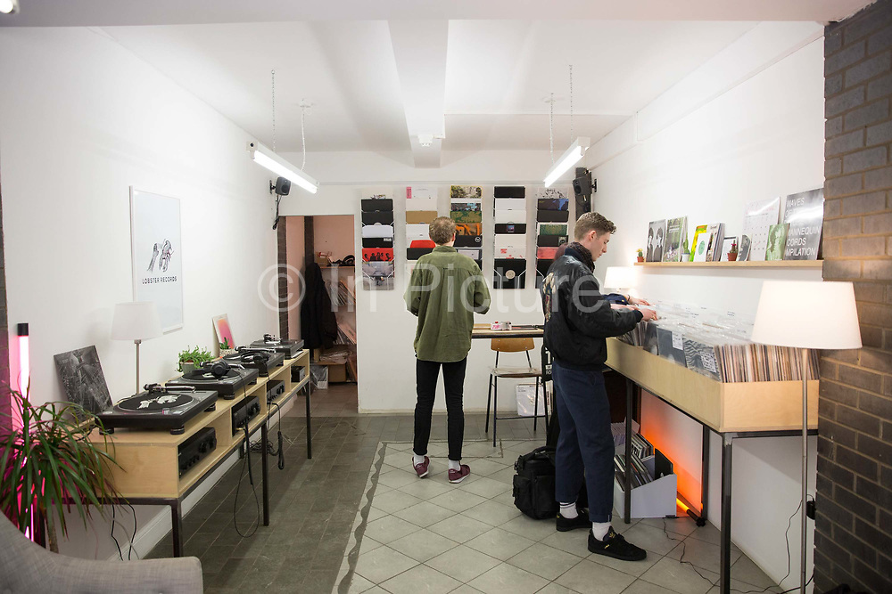 People searching for vinyl records at the independent record store Lobster Records in Hackney on the 29th March 2018 in East London in the United Kingdom.