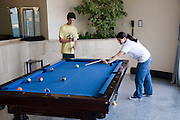 Two Teens of 16 playing Billiards