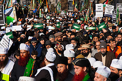 London, February 8th 2015. Muslims demonstrate outside Downing Street  to denounce the uncivilised expressionists reprinting of the cartoon image of the Holy Prophet Muhammad. PICTURED: Up to 10,000 Muslims converged from all over the UK to add their voices to the demonstration.