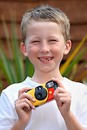 Young Boy Holding a Camera.