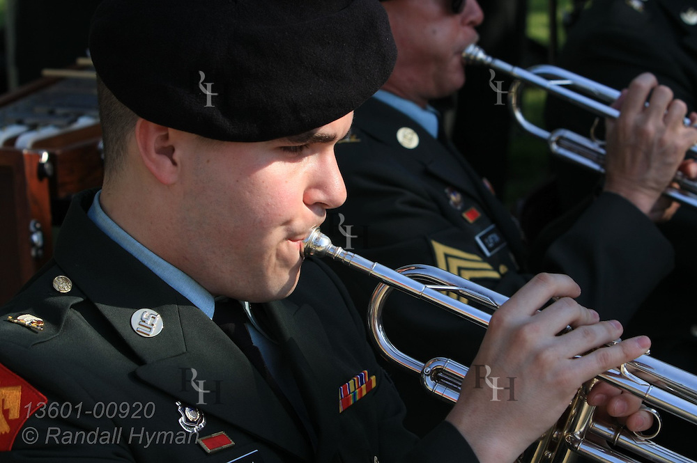 Musician plays trumpet at National Guard army band performance during Oklahoma Military Academy reunion at Rogers State University; Claremore, Oklahoma.