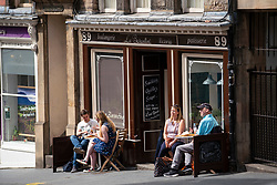Edinburgh, Scotland, UK. 12 July, 2020, Business slowly returning to normal in Edinburgh city centre. Tourists still almost non existent and streets remain very quiet in the Old Town. Iain Masterton/Alamy Live News