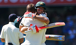 Australia's Mitchell Marsh congratulates his brother Shaun Marsh celebrates his century during day four of the Ashes Test match at Sydney Cricket Ground.