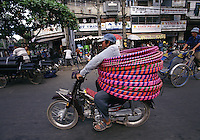 """Transporting Hoola Hoops, Saigon, Vietnam<br /> Available as Fine Art Print in the following sizes:<br /> 08""""x12""""US$   100.00<br /> 10""""x15""""US$ 150.00<br /> 12""""x18""""US$ 200.00<br /> 16""""x24""""US$ 300.00<br /> 20""""x30""""US$ 500.00"""