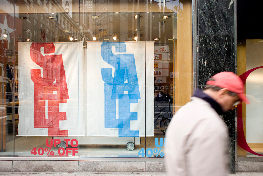 4 October, 2008. Sale signs in the Gap store of Herald Square. As the financial crisis spread last month, many retailers hit the panic button, offering more generous discounts than they did at the same time last year. But the promotions did little to convince cautious shoppers to open their wallets.<br /> <br /> ©2008 Gianni Cipriano for The Wall Street Journal<br /> cell. +1 646 465 2168 (USA)<br /> cell. +1 328 567 7923 (Italy)<br /> gianni@giannicipriano.com<br /> www.giannicipriano.com