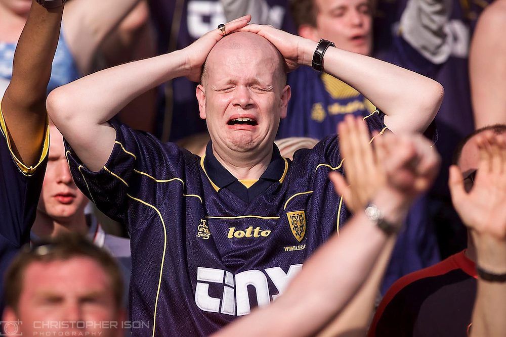 The thought of First Division football is unbearable for one distraught Wimbledon fan as he witnesses his team's relegation from the Premiership on the last day of the season after losing to Southampton at The Dell.