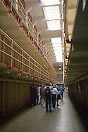 Tourists visiting the prisoner jail cell blocks on Alcatraz, San Francisco, California