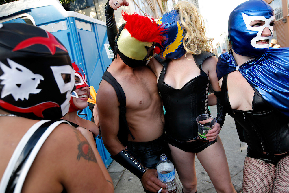 Mark Hanley, middle left, and Sage Travigne, middle right, embrace each other while standing with their friends at the Folsom Street Fair in San Francisco, CA Sunday, September 30, 2007...Note: (Others did not want to give their names)..Event on 9/30/07 in San Francisco..Erin Lubin / For the Chronicle