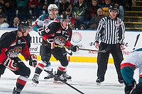 KELOWNA, CANADA - JANUARY 3: Rourke Chartier #14 of Kelowna Rockets back checks Jansen Harkins #12 of Prince George Cougars on January 3, 2015 at Prospera Place in Kelowna, British Columbia, Canada.  (Photo by Marissa Baecker/Shoot the Breeze)  *** Local Caption *** Rourke Chartier; Jansen Harkins;