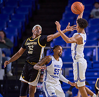Southern Miss Golden Eagles forward Leonard Harper-Baker (32) reaches for a rebound as Middle Tennessee Blue Raiders guard Donovan Sims (3) grabs the ball during the Southern Mississippi Golden Eagles at Middle Tennessee Blue Raiders college basketball game in Murfreesboro, Tennessee, Saturday, March, 7, 2020.<br /> Photo: Harrison McClary/All Tenn Sports