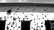 Bullet and grenade holes at Camp Kigali where 10 Beligan peacekeepers guarding Prime Minister Agathe Uwilingiyimana were murdered by the Presidential Guard on the first day of the genocide. Over a 90-day period in 1994, Hutu extremists massacred around one million Tutsi and moderate Hutus.