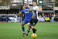 AFC Wimbledon midfielder Liam Trotter (14) tackling Peterborough United attacker Marcus Maddison (11) during the EFL Sky Bet League 1 match between AFC Wimbledon and Peterborough United at the Cherry Red Records Stadium, Kingston, England on 12 November 2017. Photo by Matthew Redman.