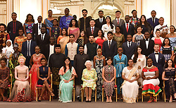 Queen Elizabeth II (centre front) joins some of the Queen's Young Leaders, who received their award at Buckingham Palace, for a group photograph.