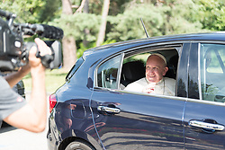 """21 June 2018, Geneva, Switzerland: After an Ecumenical Encounter between Pope Francis and the World Council of Churches, Pope Francis says farewell to WCC leadership outside the Ecumenical Centre. On 21 June 2018, the World Council of Churches receives a visit from Pope Francis of the Roman Catholic Church. Held under the theme of """"Ecumenical Pilgrimage - Walking, Praying and Working Together"""", the landmark visit is a centrepiece of the ecumenical commemoration of the WCC's 70th anniversary. The visit is only the third by a pope, and the first time that such an occasion was dedicated to visiting the WCC."""