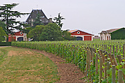 Chateau l'Evangile vineyard, chateau building and distinctive red winery  Pomerol  Bordeaux Gironde Aquitaine France