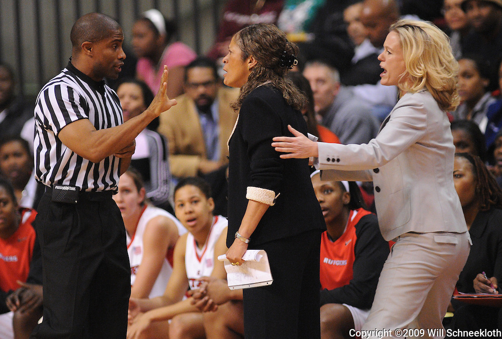 Mar 2, 2009; Piscataway, NJ, USA; Rutgers head coach C. Vivian Stringer (center) is restrained by associate head coach Carlene Mitchell while reacting to a foul call during the first half of Rutgers game against nationally rated #1 Connecticut at the Louis Brown Athletic Center. Connecticut won 69-59 to finish their regular season a perfect 30-0.
