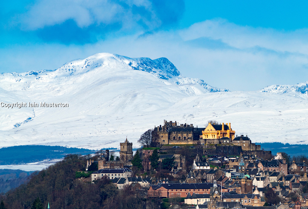 View of Stirling Castle and snow covered mountains in Stirlingshire, Scotland,UK