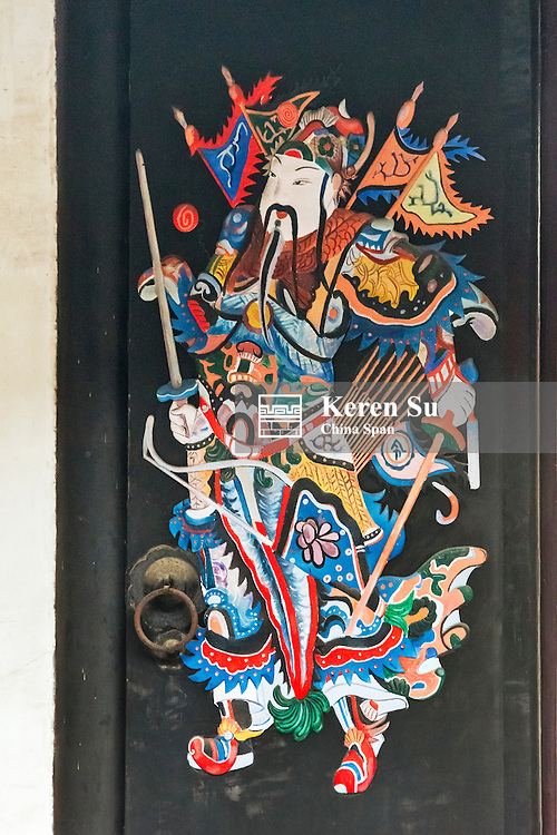 Door decorated with poster of Guarding God, Nanxun Ancient Town, Zhejiang Province, China