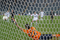 Real Madrid's Luis Figo scores a decisive penalty past Roma's diving goalkeeper Ivan Pelizzoli in an empty Stadio Olympico. Fans were banned after the referee was hit by a missle during a previous Champion's League match.