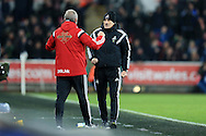 Swansea city head coach Francesco Guidolin ® celebrates with his assistant Alan Curtis at the final whistle after his team win 1-0. Barclays Premier league match, Swansea city v Aston Villa at the Liberty Stadium in Swansea, South Wales on Saturday 19th March 2016.<br /> pic by  Andrew Orchard, Andrew Orchard sports photography.