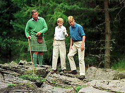 File photo dated 16/8/1997 of the Prince of Wales and his sons Prince William (right) and Prince Harry, above the Falls of Muick on the Balmoral Estate in Scotland, during a summer break.