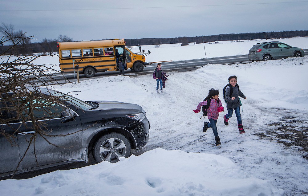 Syrian refugee kids from the Al Jasem family return home after being dropped off in a school bus to their temporary home in Picton, Ontario, Canada, Wednesday January 20, 2016.   (Mark Blinch for the BBC)