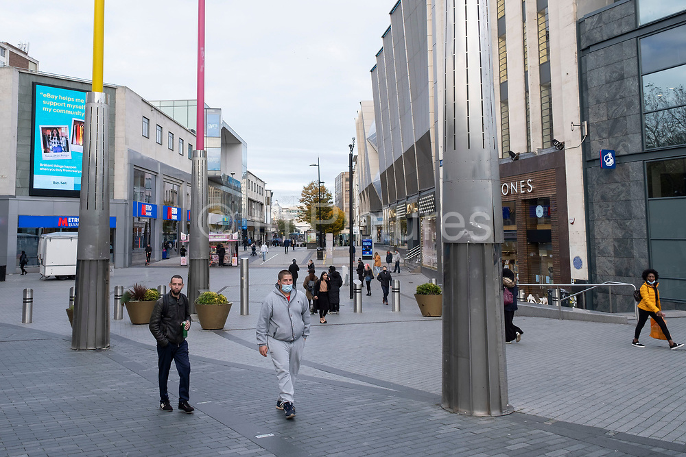 With a fraction of the normal numbers of shoppers around on the day that the second national lockdown came into effect, some people, many of whom are wearing face masks, come to a very quiet Bull Ring in the city centre as all non-essential shops are closed while others remain trading on 5th November 2020 in Birmingham, United Kingdom. The new national lockdown is a huge blow to the economy and for individual businesses who were already struggling with only offering limited services.
