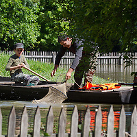Man tries to catch fish in the floodwater in a flooded garden of a house in the forest in Gemenc (about 218 km South of the capital city Budapest), Hungary on June 14, 2013. ATTILA VOLGYI
