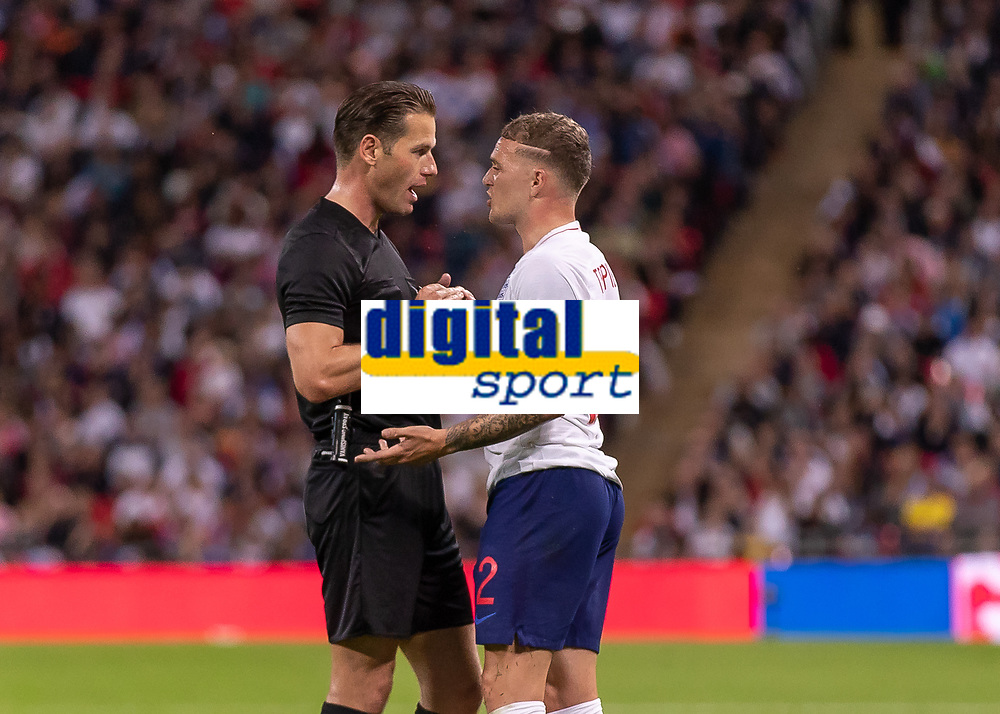 Football - 2018 / 2019 UEFA Nations League A - Group Four: England vs. Spain<br /> <br /> Kieran Trippier (England) gets spoken to by Referee Danny Makkelie (NED) as he concedes the free kick that lead to Spains second goal at Wembley Stadium.<br /> <br /> COLORSPORT/DANIEL BEARHAM