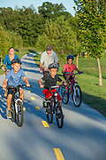 Bikers ride on the Razorback Greenway at Lake Fayetteville on Sunday, Sept. 28, 2014, in Fayetteville, Arkansas. Photo by Beth Hall